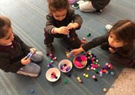 Sorting Pom Poms Big and Small Problem Solving - Cooperation (1)